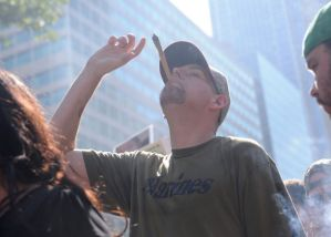 Military Veteran Mike Whiter smoking in Love Park at 4:20. (Photo by